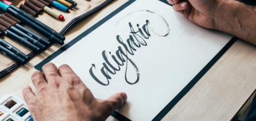 Pessoa escrevendo a palavra caligrafia